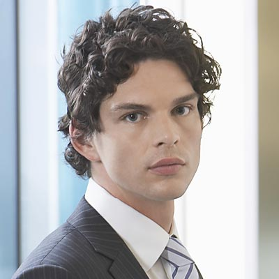 medium curly hairstyles with layered hair for men from