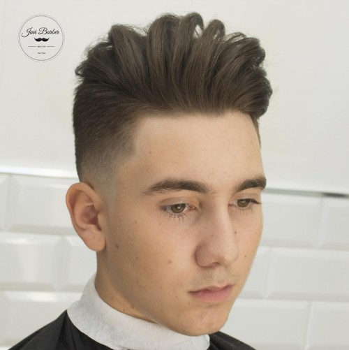 javi_thebarber high fade and separated longer hair on top