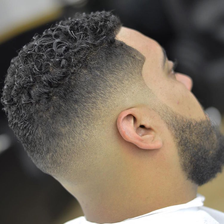 zeke_the_barber_and clean sharp fade with curls on top