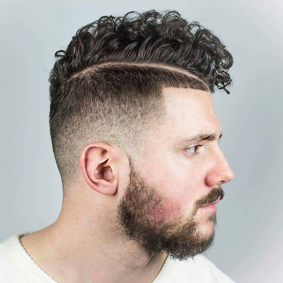 beholdthybarber_and high fade hardpart curls and volume on top