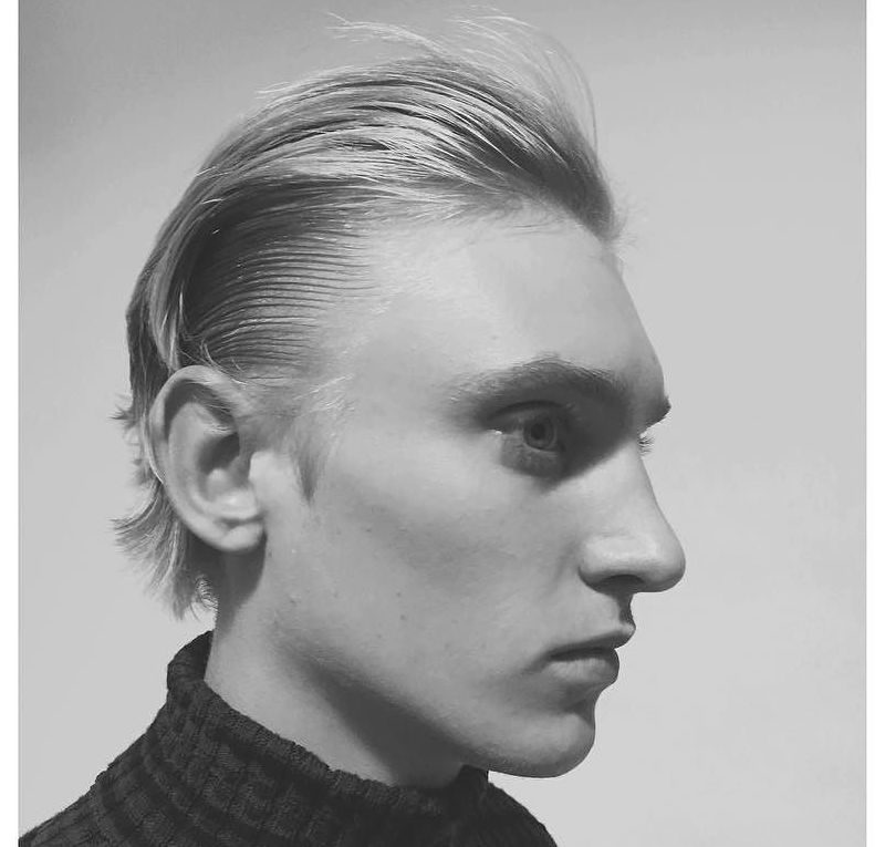 wet and dry slicked hairstyle