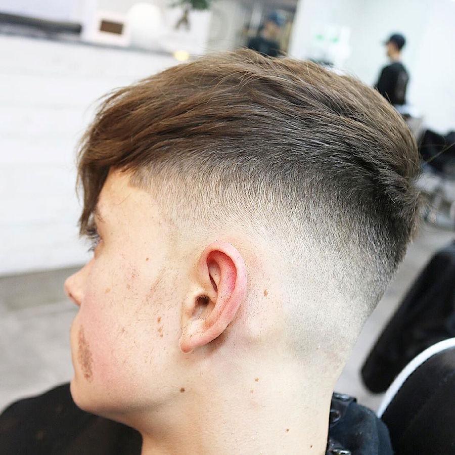 menspiresalon_and high fade blended into medium hair on top longer fringe