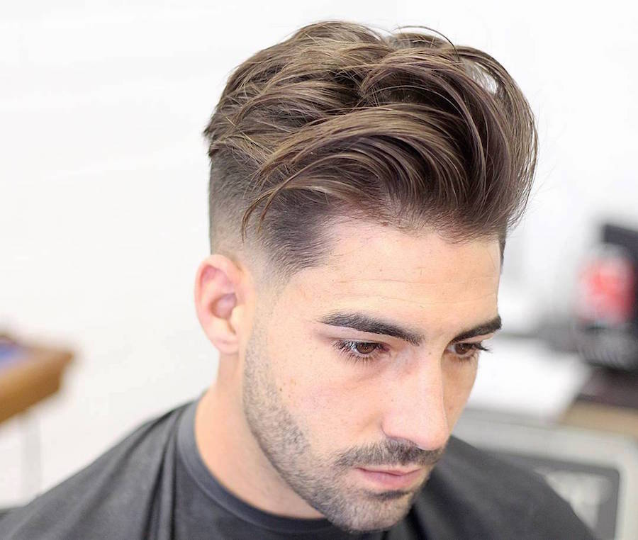 High fade haircut with medium length hair on top