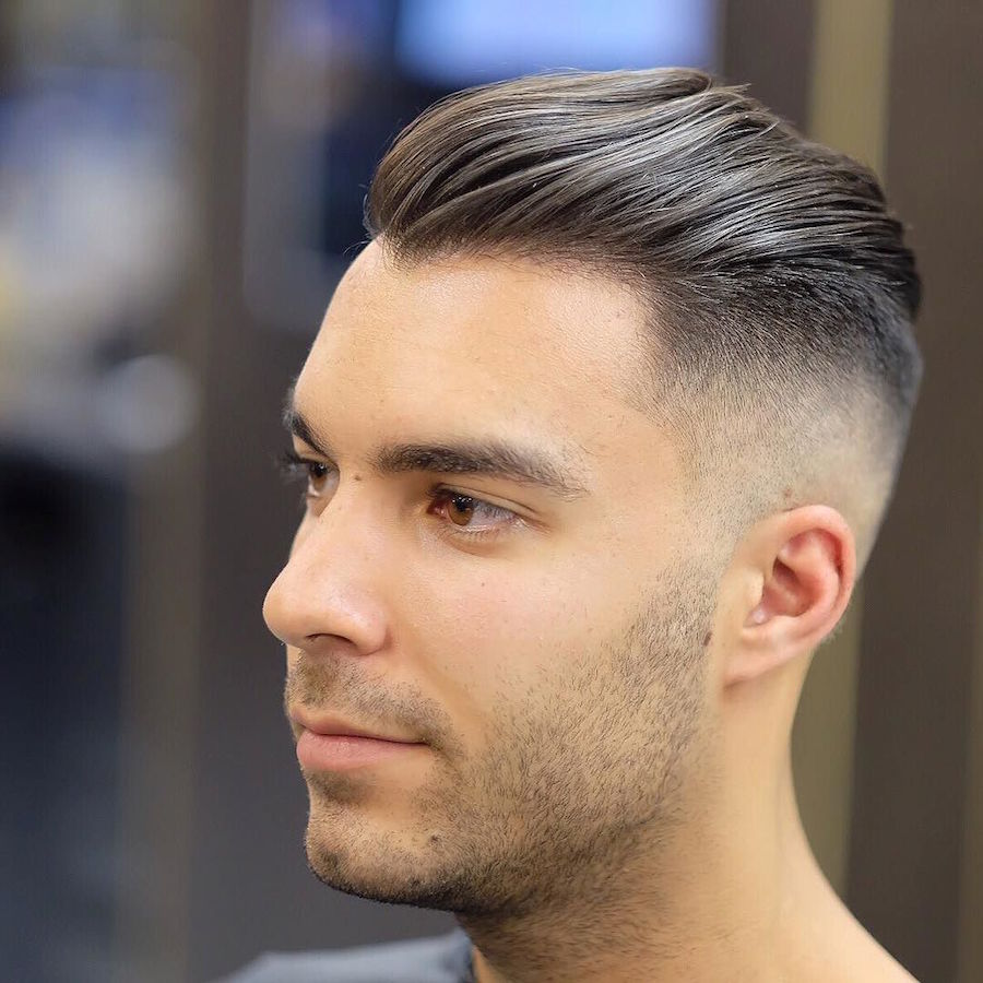 High fade slicked back medium length men's hairstyle
