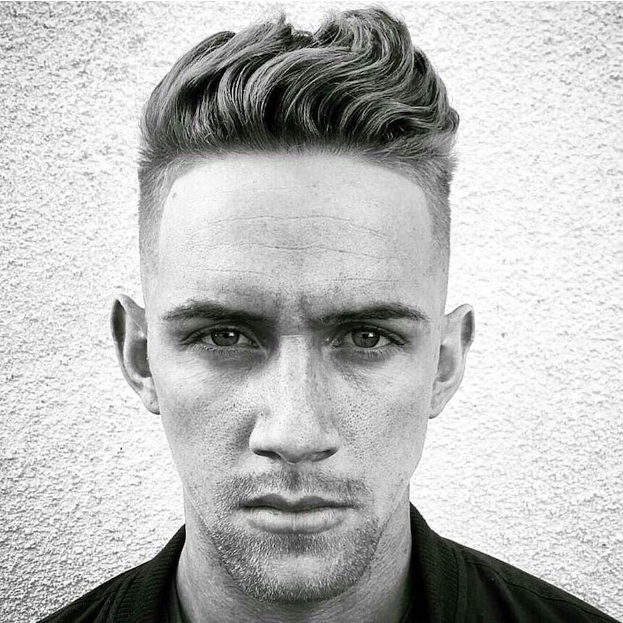 nicholas_the_greek_and wavy textures on top and short sides haircut