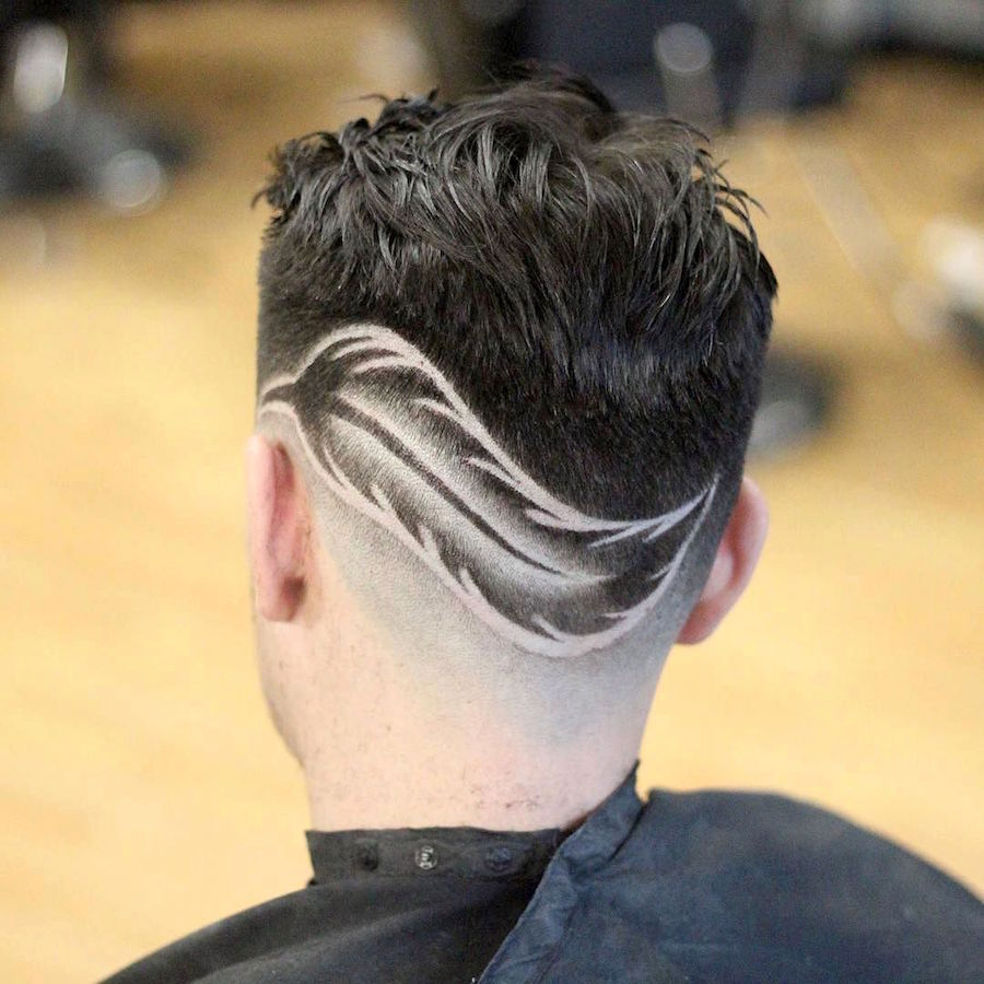 barberdiaz_and sharp fade haircut with feather design