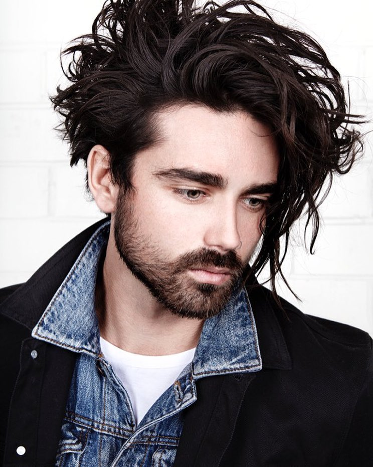 Long Top + Medium Sides + Wavy Texture. Morrismotley_and Long Curly Messy  Hairstyle For Men