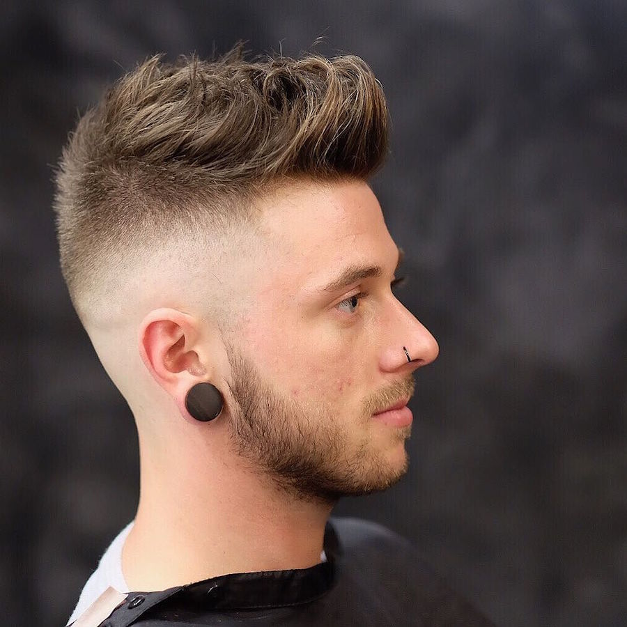 rokkmanbarbers_and mid to high skin fade longer textures on top haircut