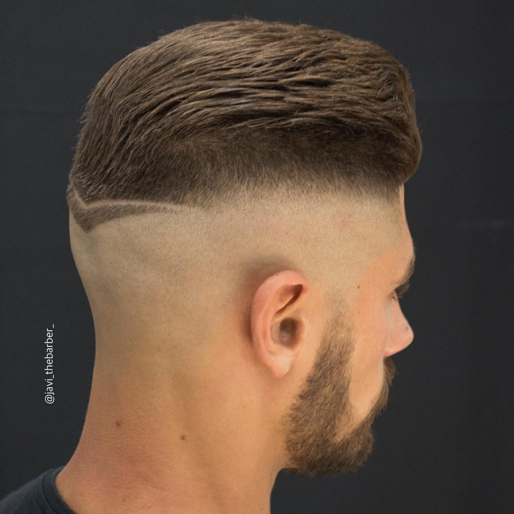 Thick short haircut for men with bald fade and hair design