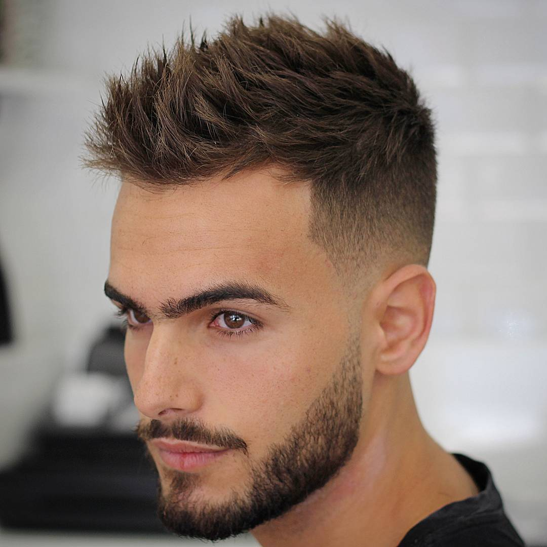 Short men's haircut with textured hair and high fade