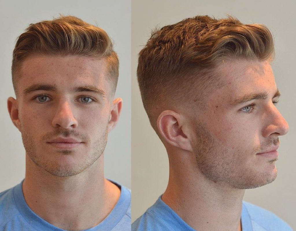Short haircut for men with shaved sides and medium hair on top