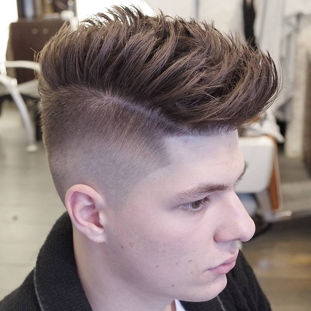 high fade haircut with long textures