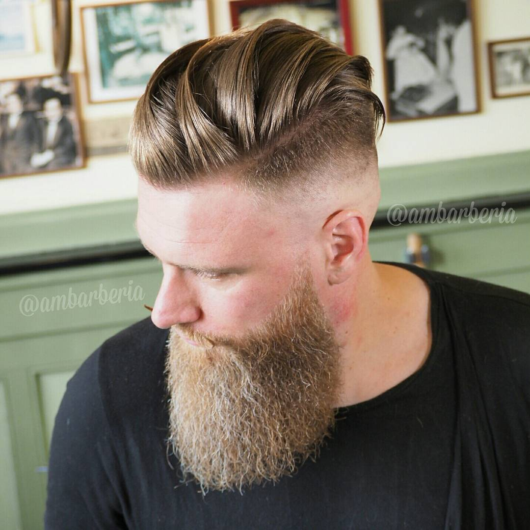 Long hair slicked back undercut with high skin fade and beard