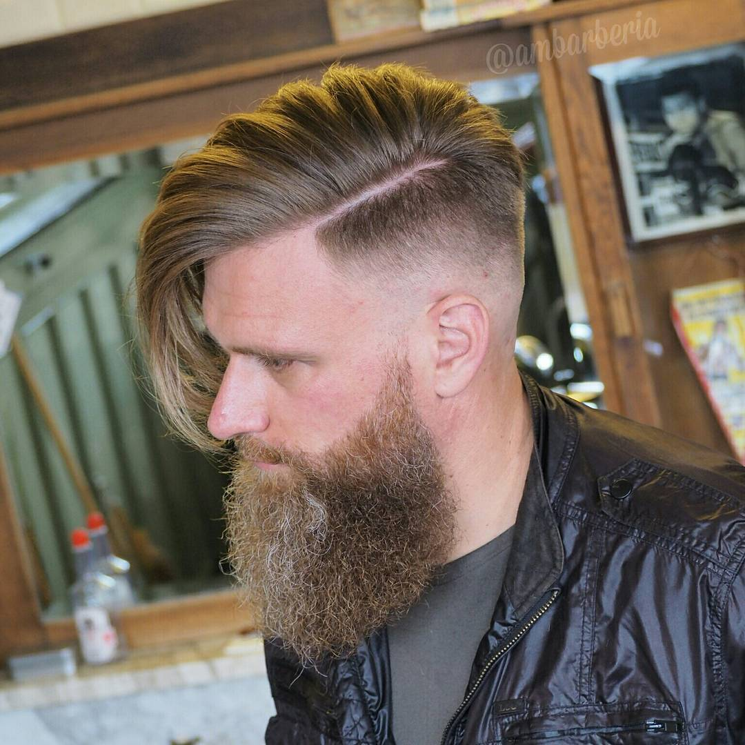 Undercut haircut for men with long hair and disconnected full beard