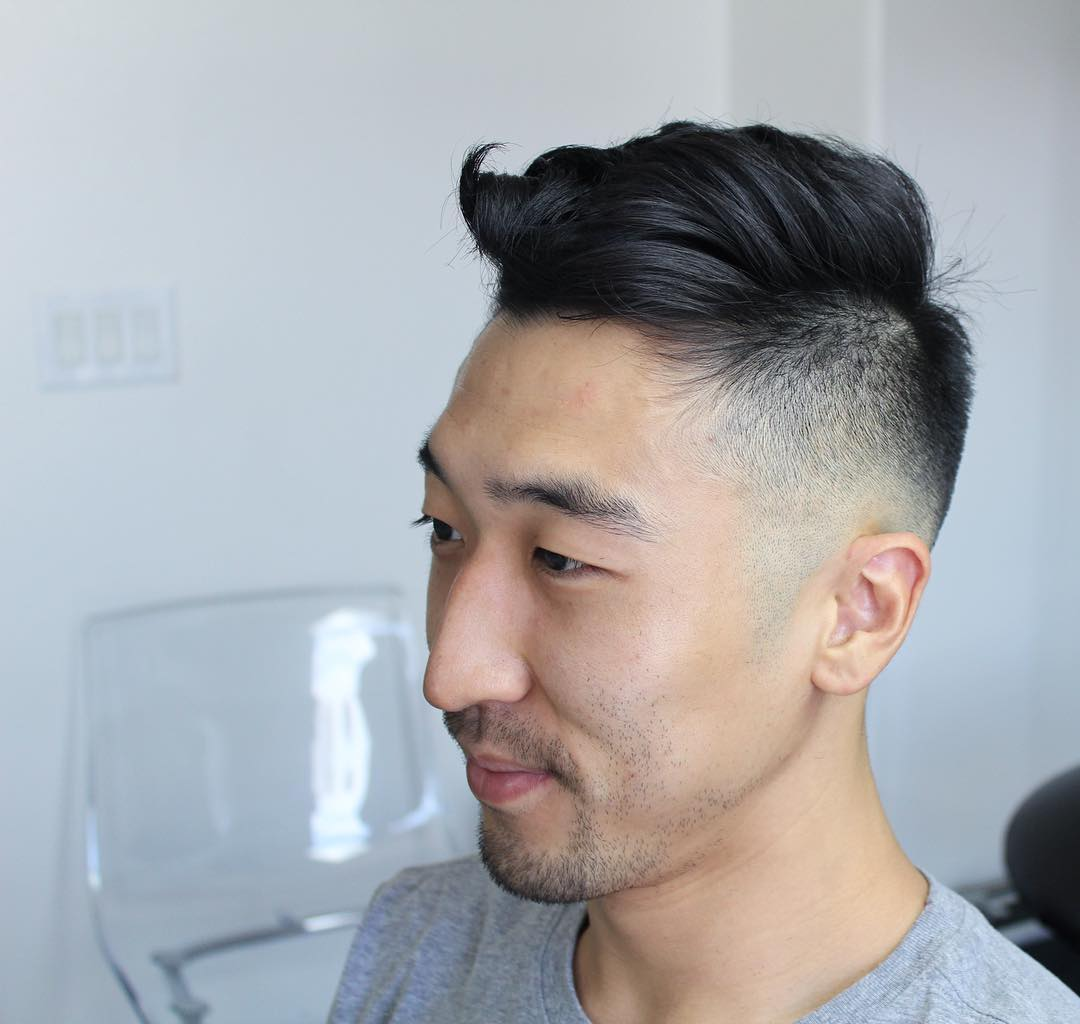 Short hair undercut for men with low bald fade