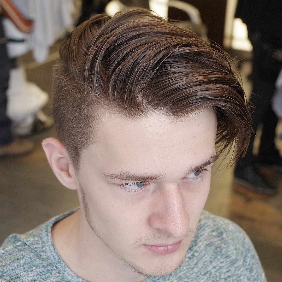 Undercut hairstyle for men with long side swept fringe