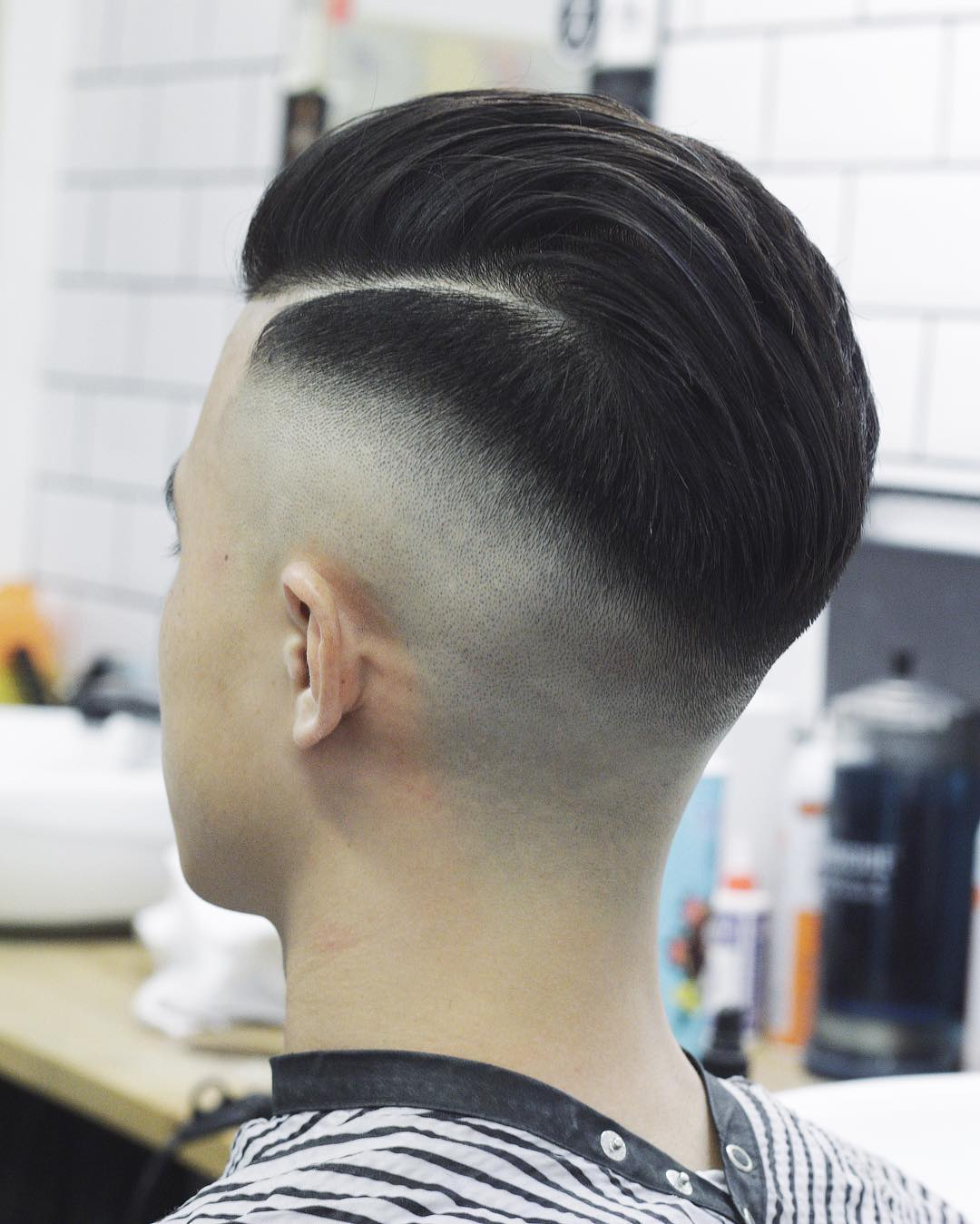 Side part pompadour skin fade haircut