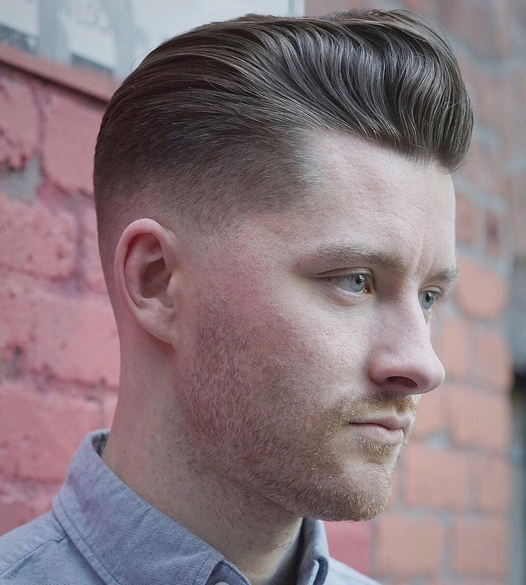 Pompadour hairstyle with a low fade