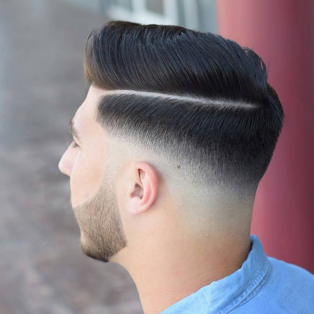 Side part haircut with a low skin fade