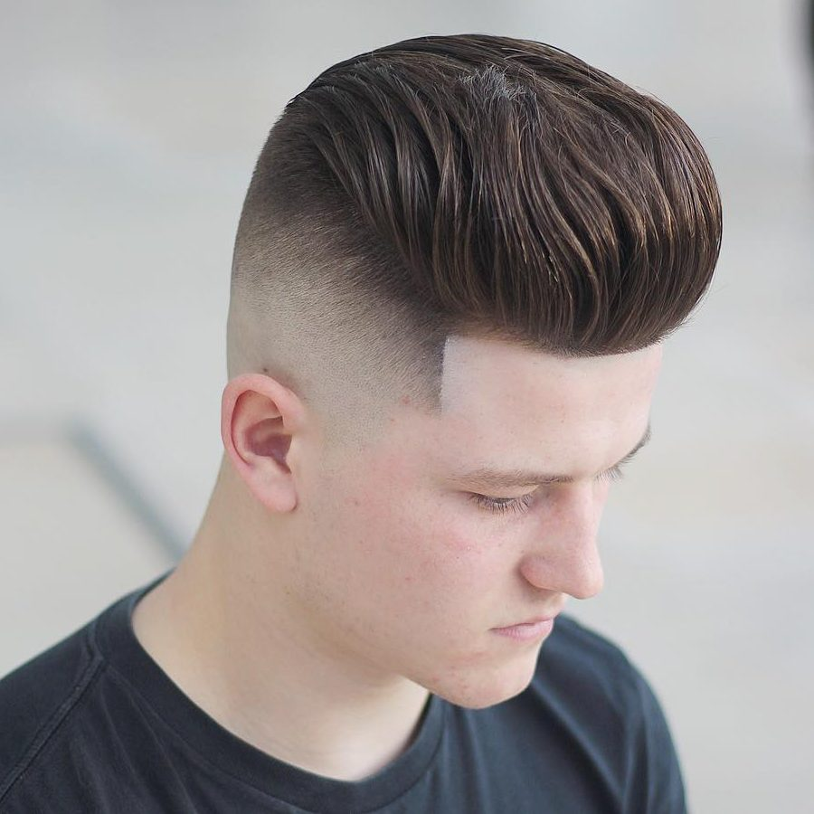 Bald fade pompadour haircut