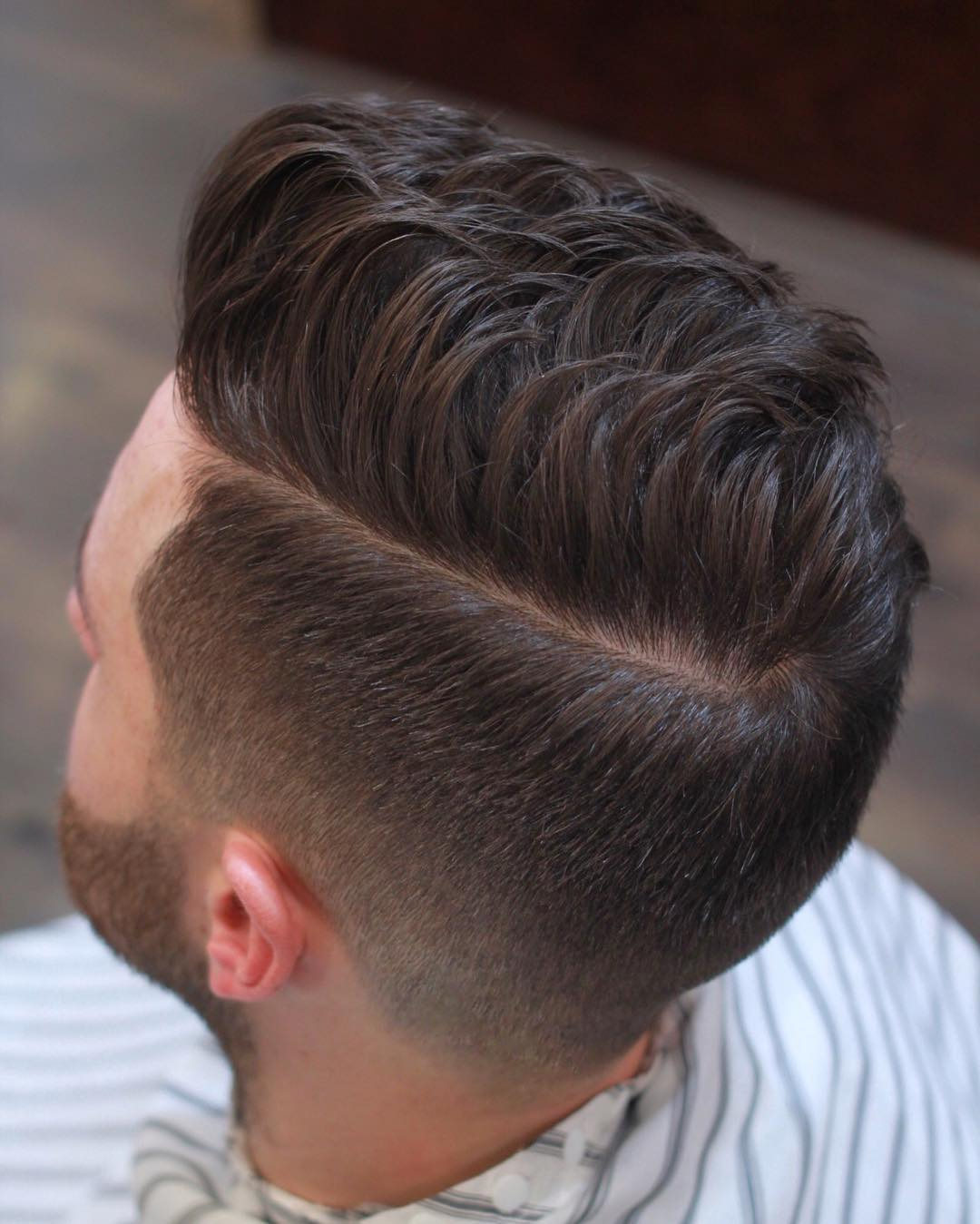 thegentlemanbarbers mid fade medium length hairstyle men
