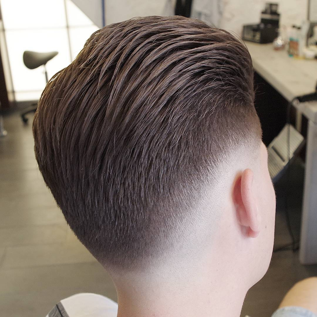 Slicked back haircut with low fade