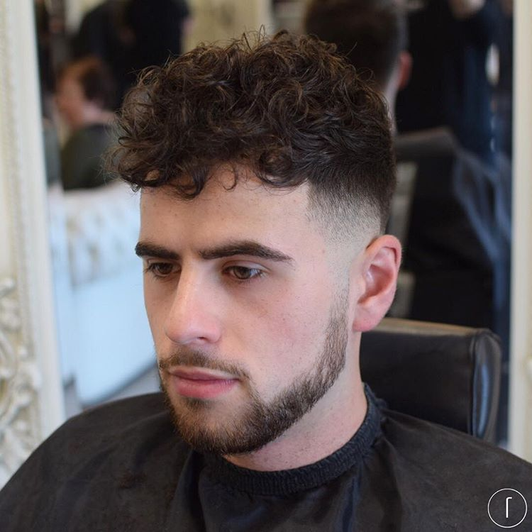 Captivating 9. Curly Hair + Mid Bald Fade