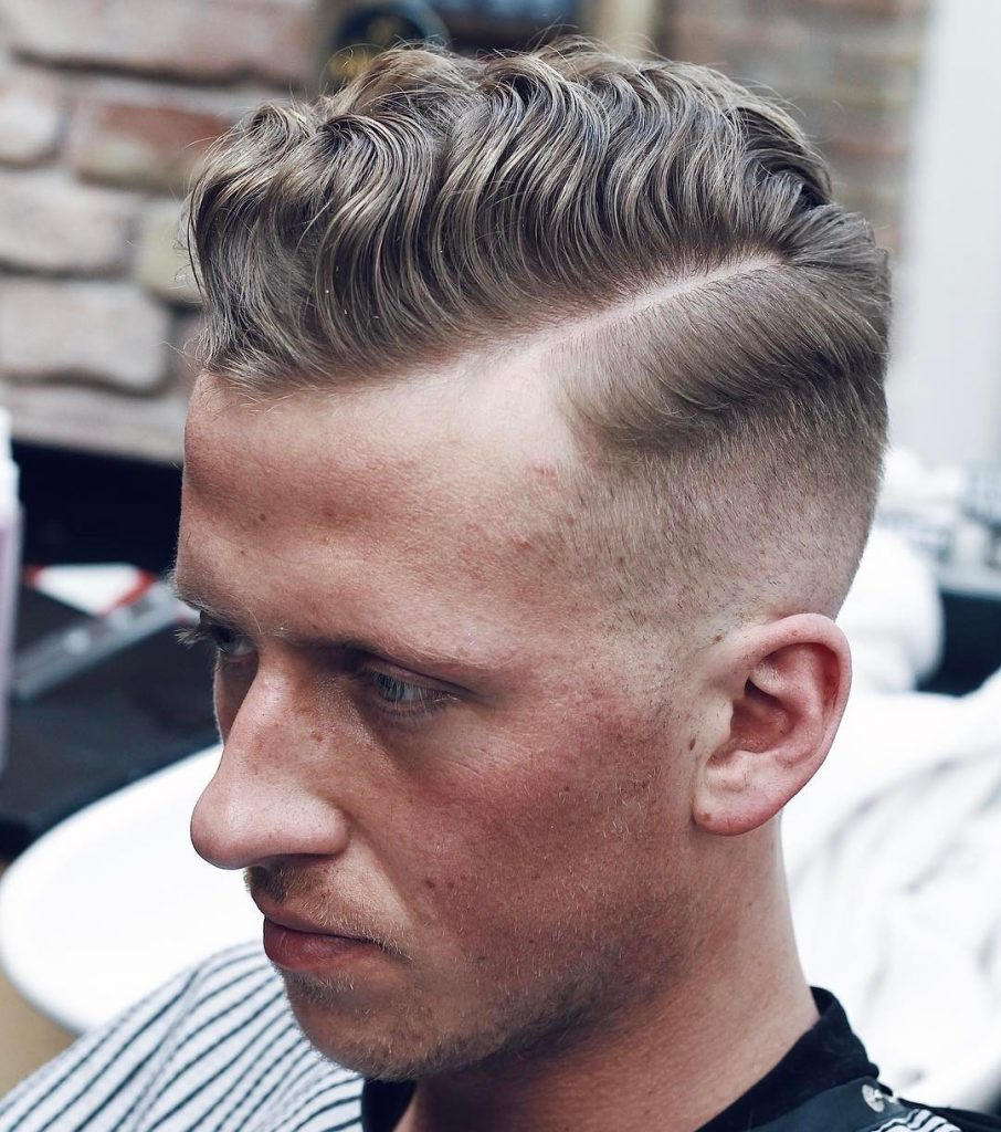 Side part hairstyle comb over with mid fade