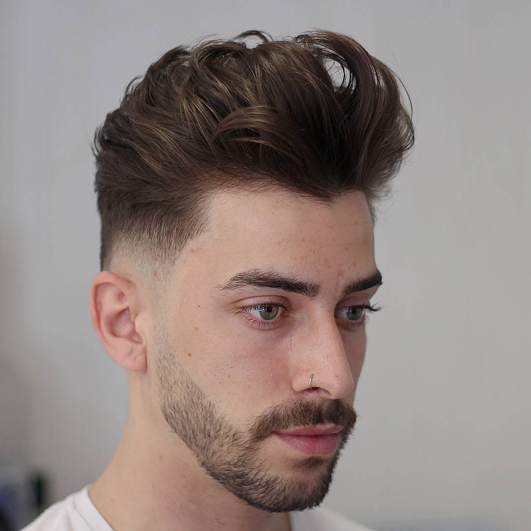 90. Low Fade + Medium Wavy Hair On Top
