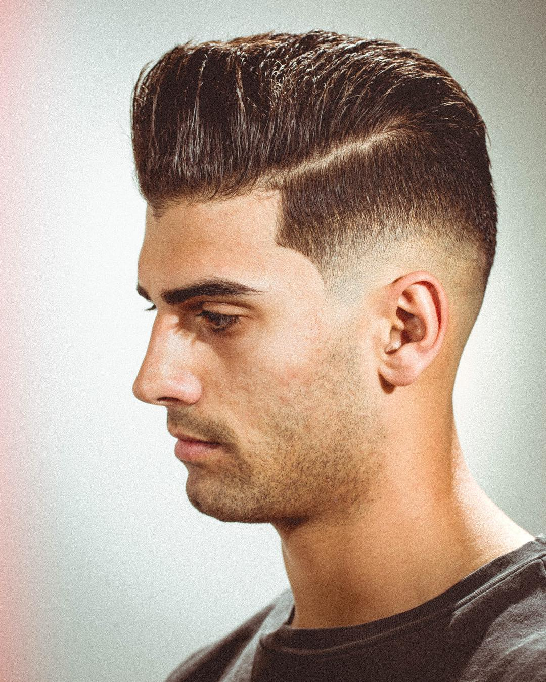 Side part pompadour hairstyle for guys
