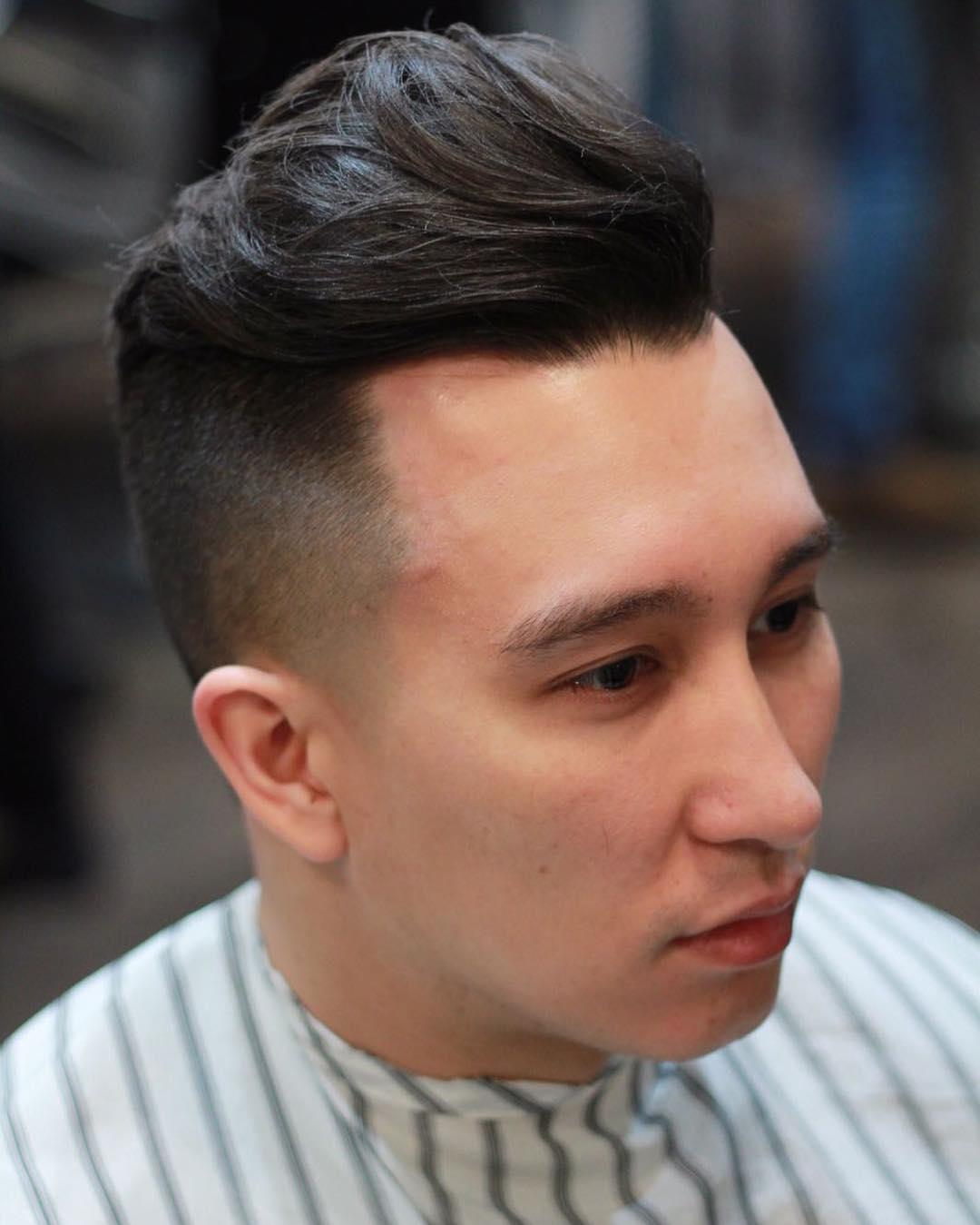 Medium length textured pompadour haircut