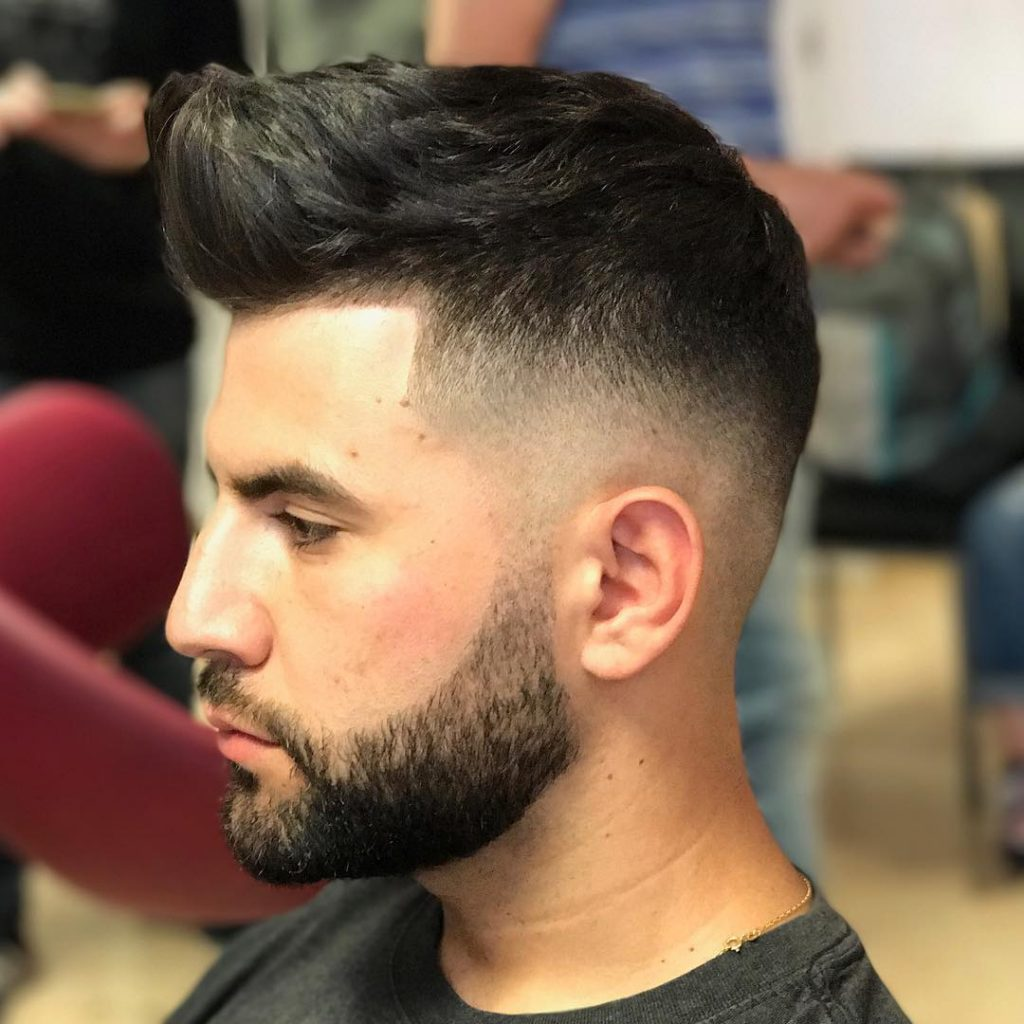 Quiff haircut with a high fade