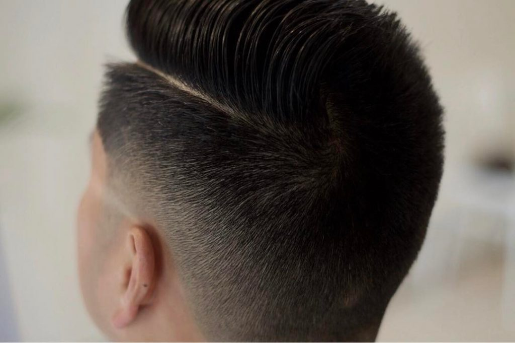 comb over fade with hard part