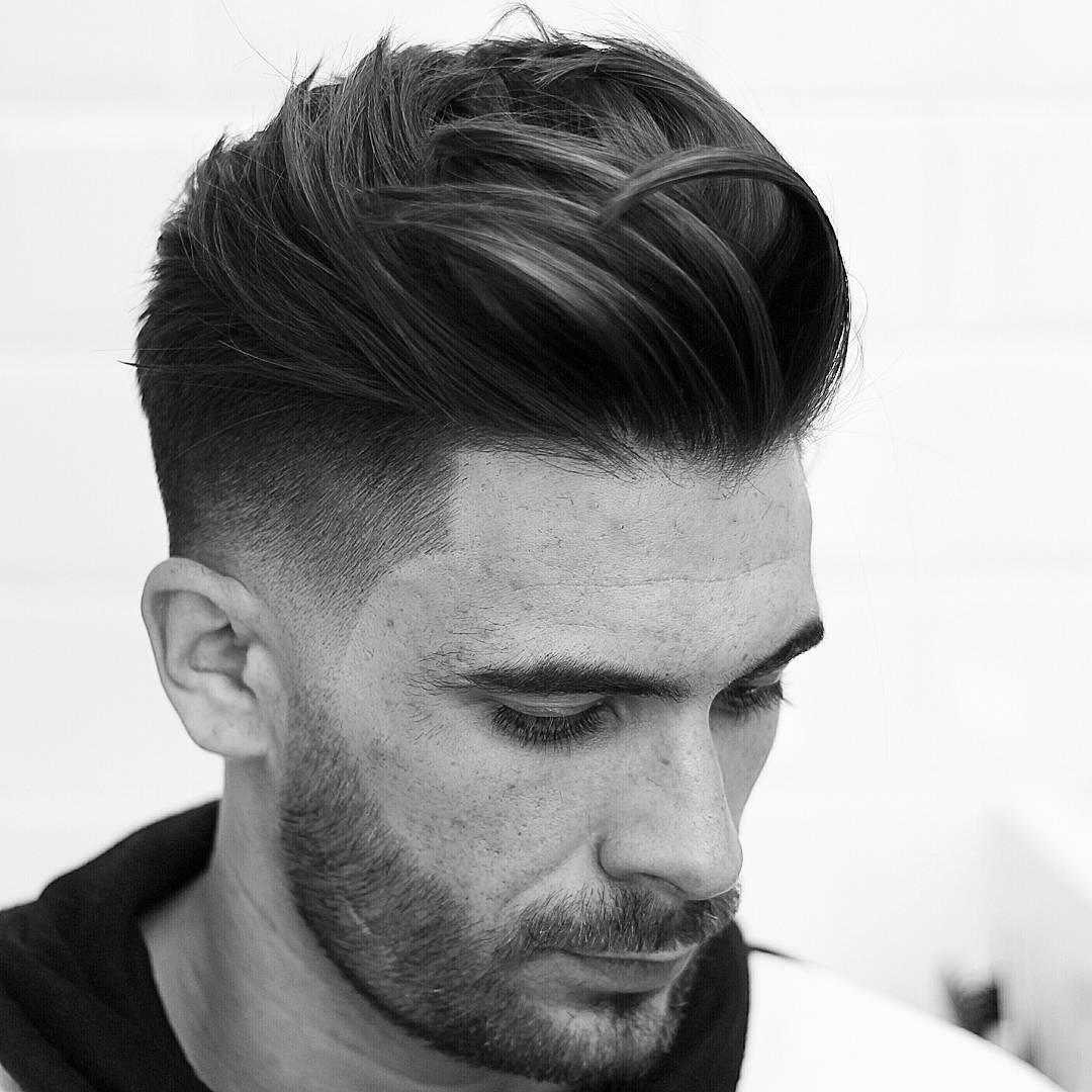 agusdeasis mid fade haircut with medium hair on top