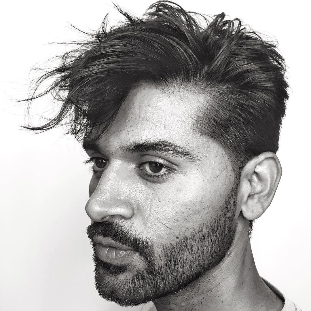 anthonythebarber916 mens haircut with long fringe wavy hair beard