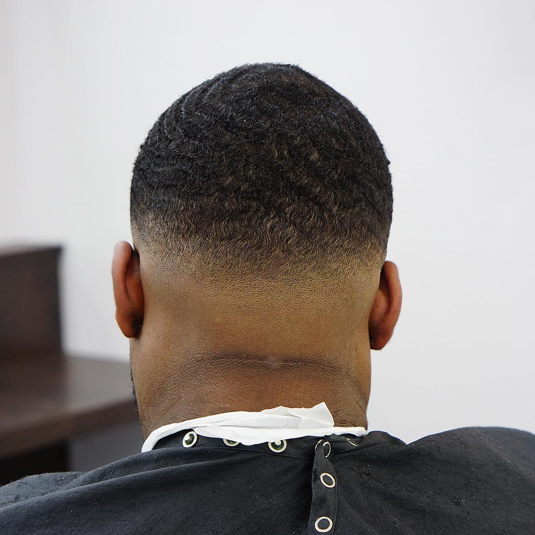 criztofferson killer waves bald fade haircut back