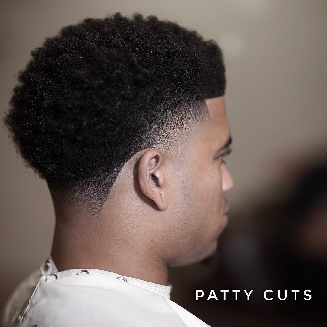 patty_cuts high skin fade blowout haircut for black men back view
