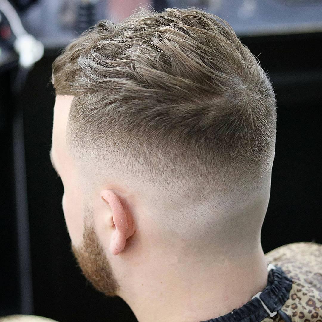 High fade haircut with short textured hair