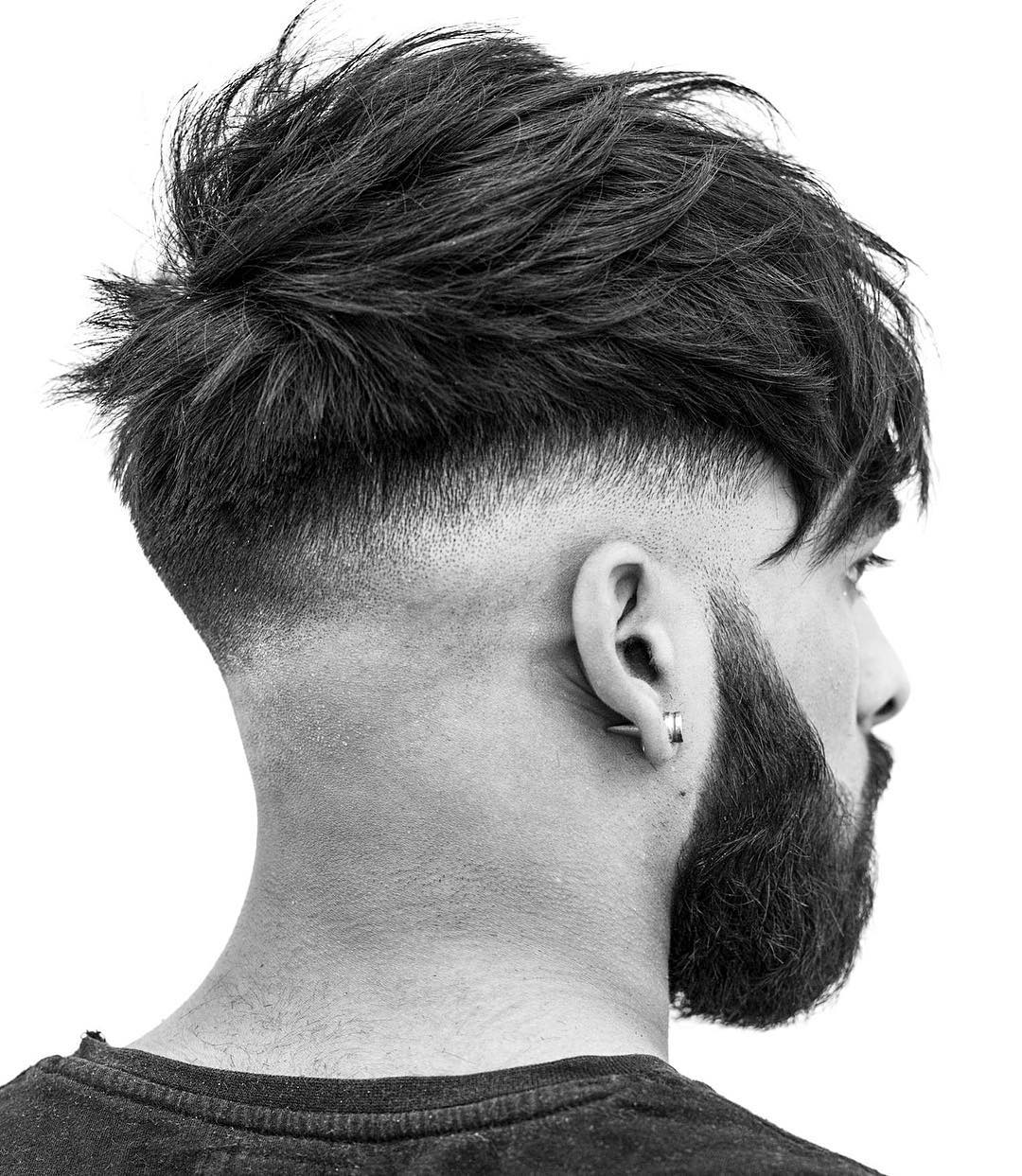 r.braid low bald fade messy textured mens haircut