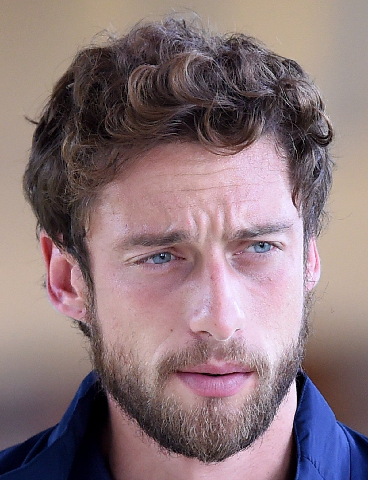 23 soccer player haircuts juventus and italy national team midfielder claudio marchisios short all over curly hair and beard is a low maintenance and attractive look for guys with winobraniefo Images