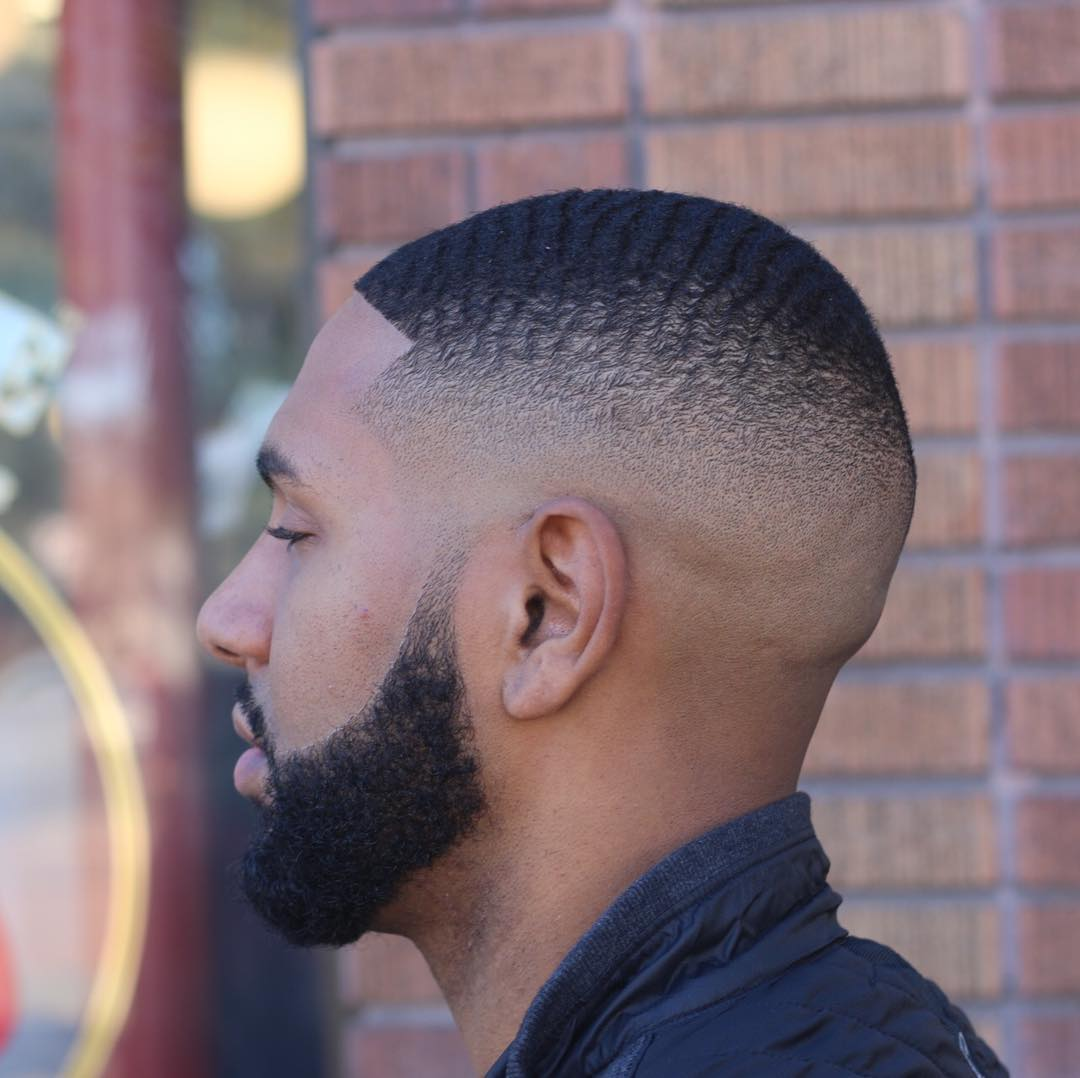 Fade haircut with waves