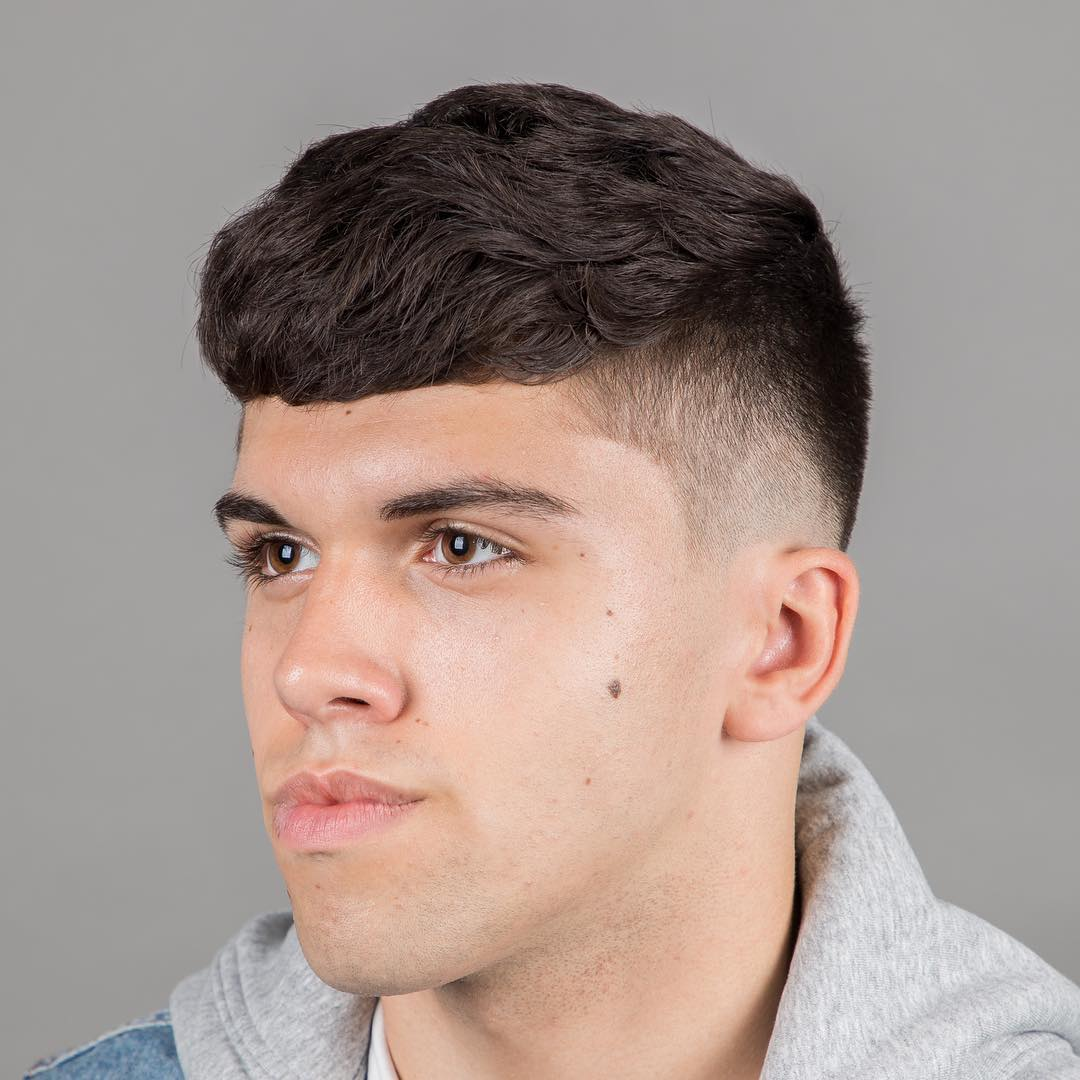 Wavy crop haircut for men with thick hair