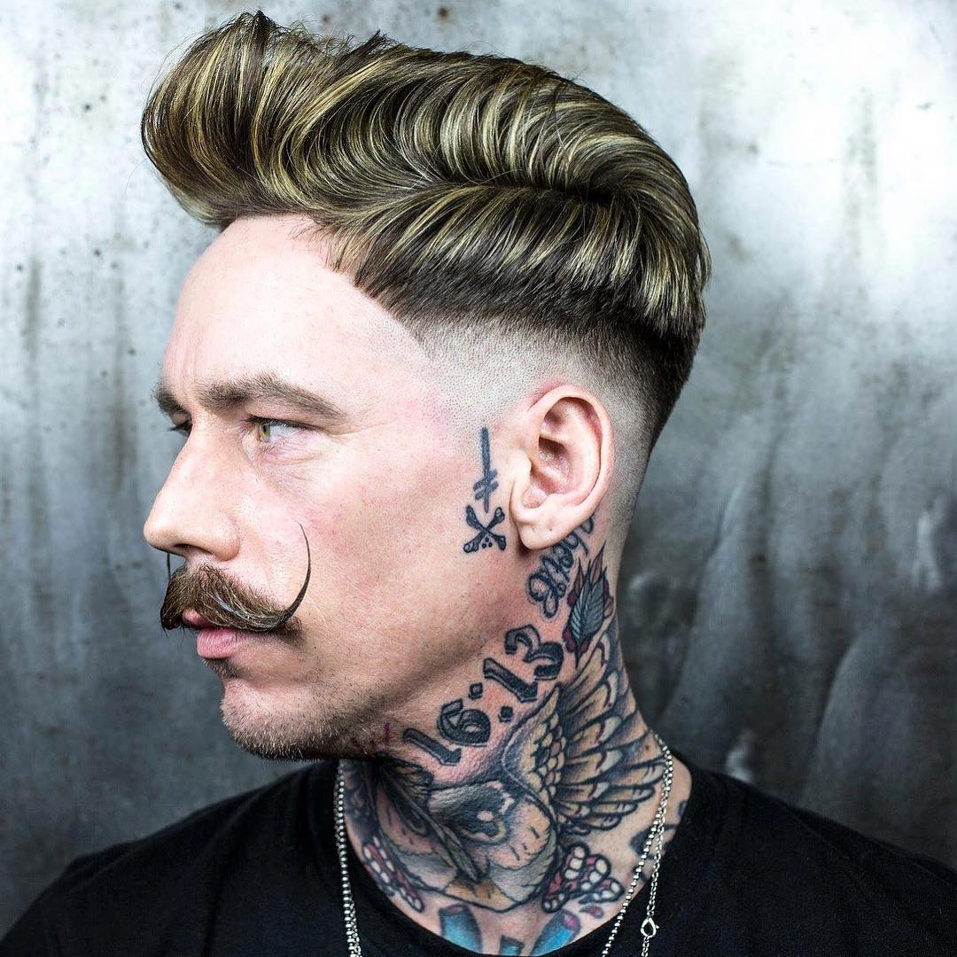 Side part pompadour quiff hairstyle for men and low bald fade
