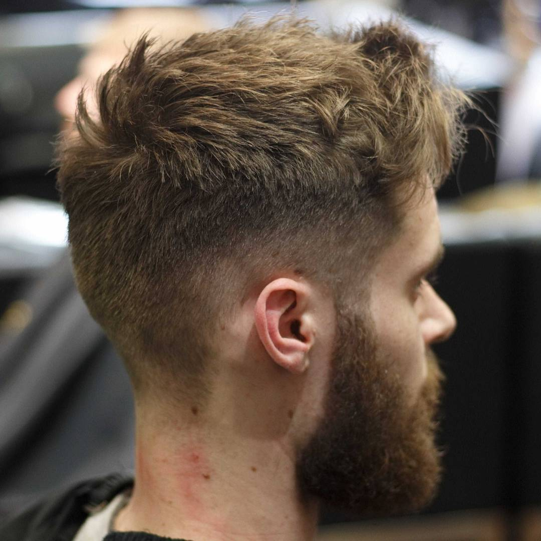 Short messy textured haircut for men high fade