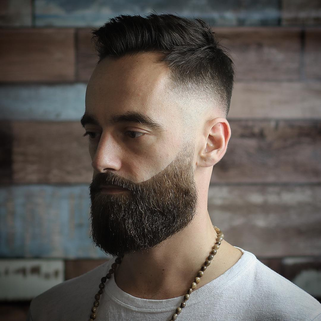 Full beard style disconnected from bald fade