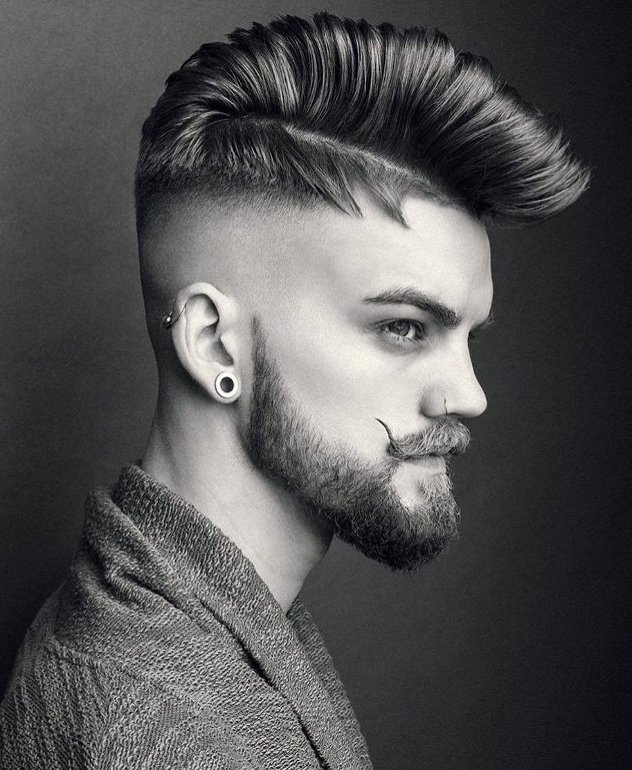 Pompadour hairstyle with high bald fade