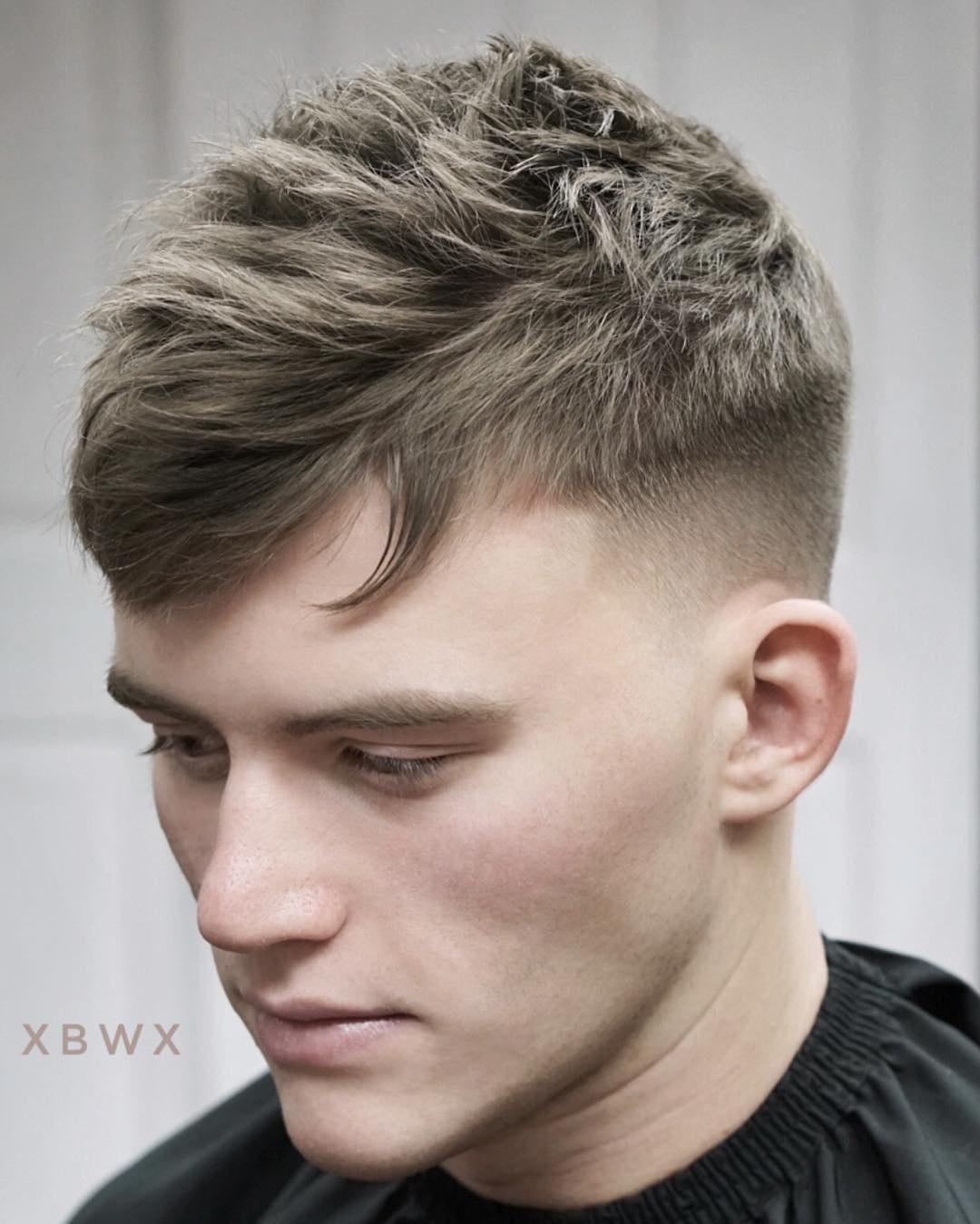Medium textured mens haircut mid fade