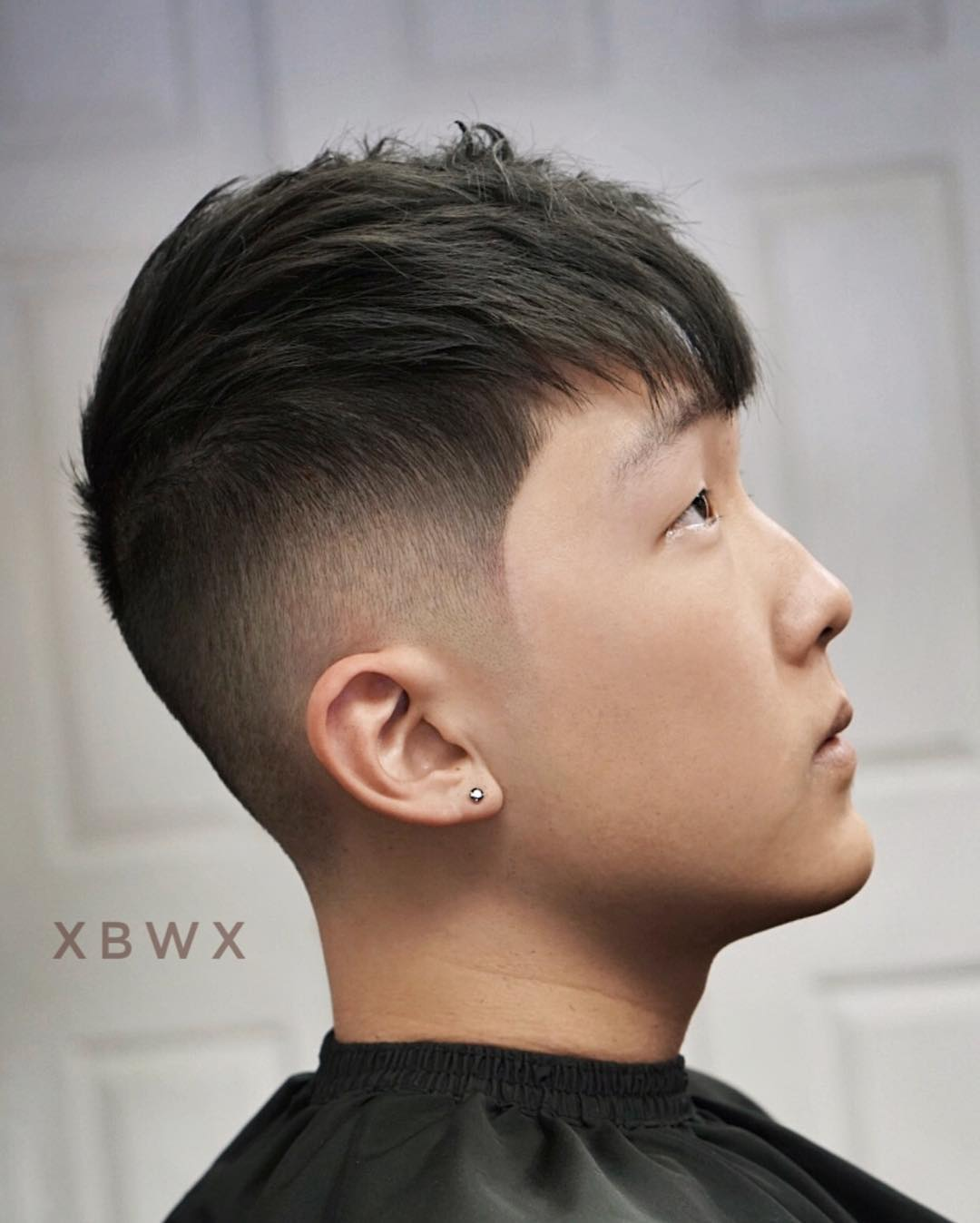 Medium textured haircut mid fade