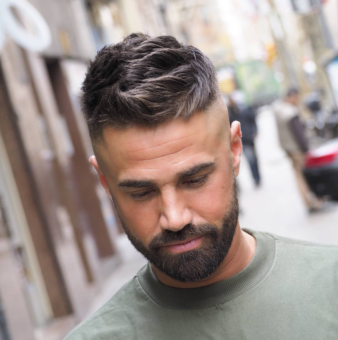 Medium textured haircut for guys and high bald fade
