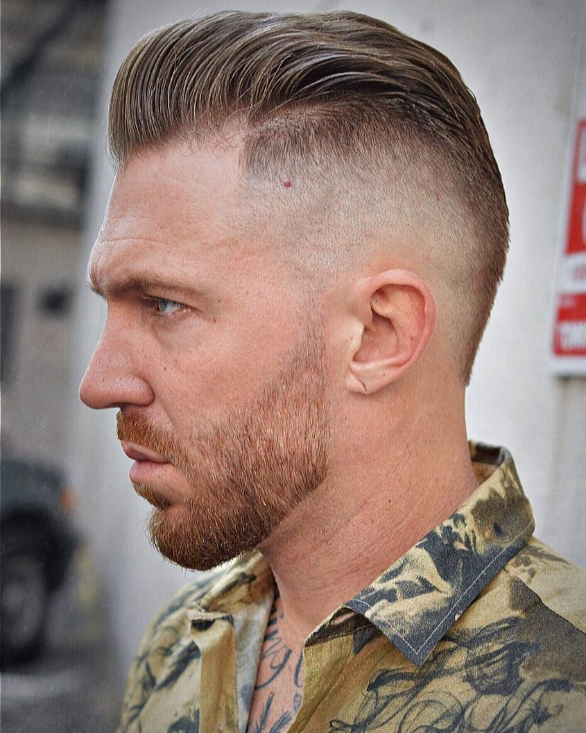 High bald fade undercut pompadour haircut